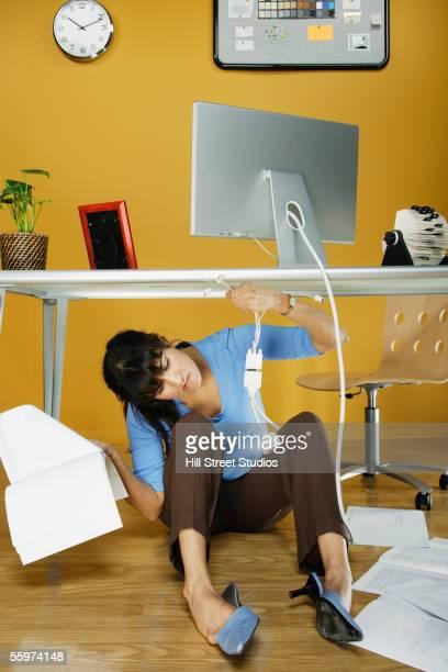 Businesswoman under desk