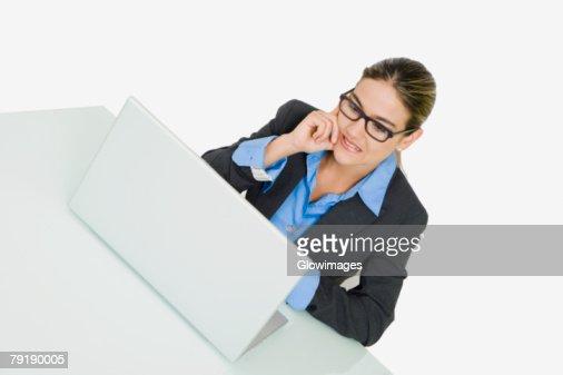 Businesswoman using a laptop : Foto de stock