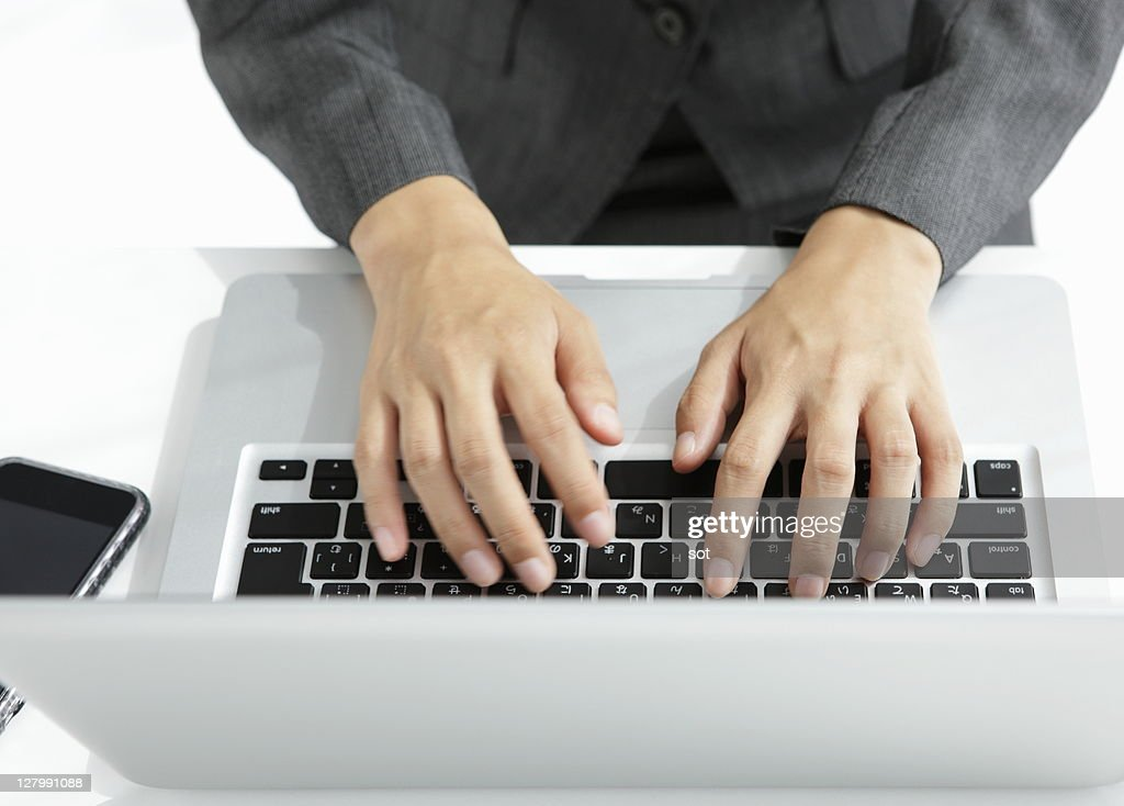 Businesswoman using a laptop,elevated view : Stock Photo