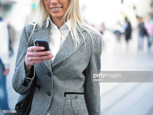 A businesswoman using a smartphone outdoors