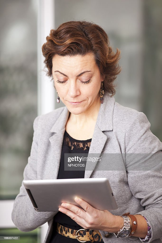 Businesswoman using a tablet : Stock Photo