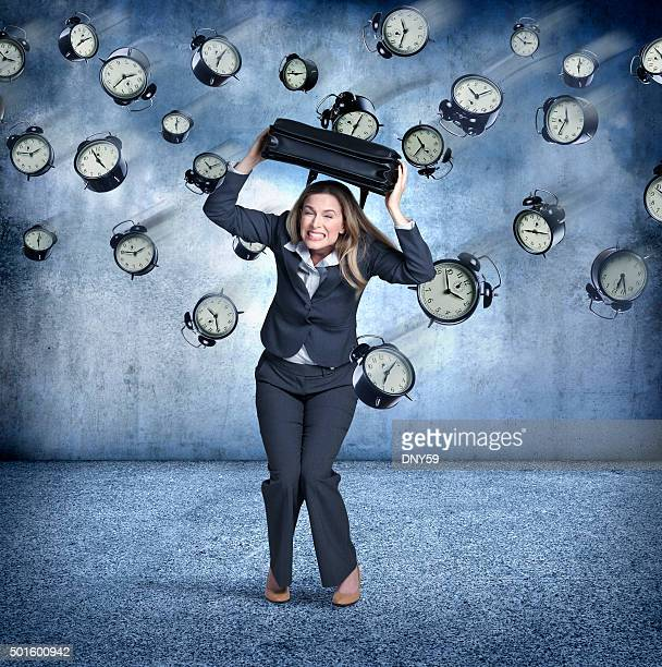 Businesswoman Using Briefcase To Protect Himaself From Flying Clocks
