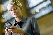 Businesswoman Using Cell Phone on the Go