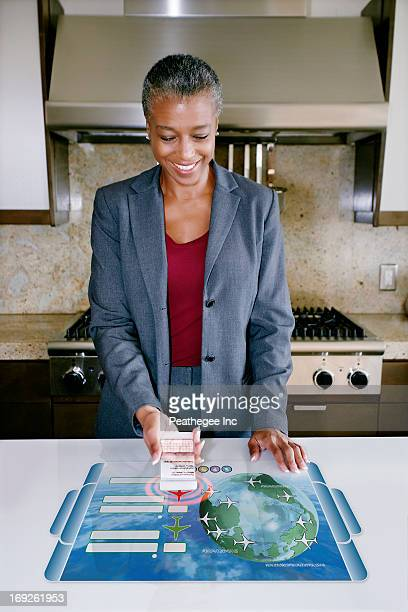 Businesswoman using computer in table