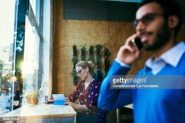 Businesswoman using digital tablet in cafe