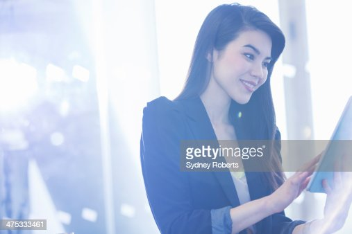 Businesswoman using digital tablet in office : Stock Photo