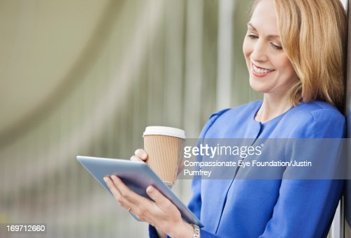 Businesswoman using digital tablet outdoors : Stock Photo