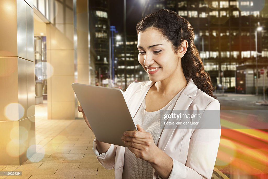 Businesswoman using handhold computer device.