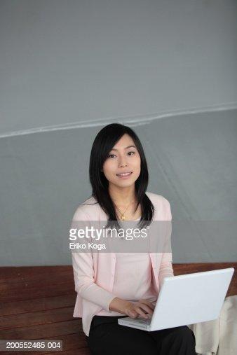 Businesswoman using laptop, elevated view, portrait : Stock Photo