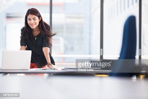 Businesswoman using laptop in modern office