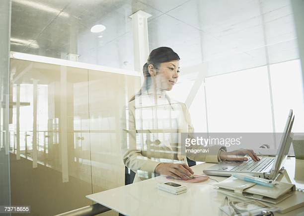 Businesswoman using laptop in the office
