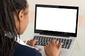 Close-up Of A Young Businesswoman Using Laptop