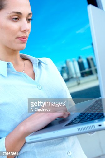 Businesswoman using laptop : Stock Photo