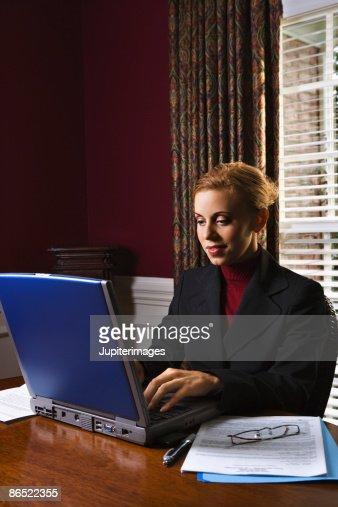 Businesswoman using laptop : Stock Photo