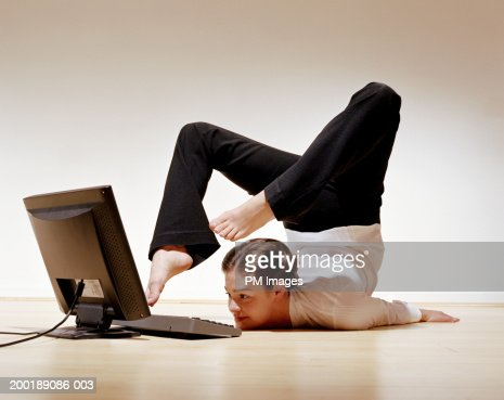 Businesswoman using laptop with toes : Stock Photo