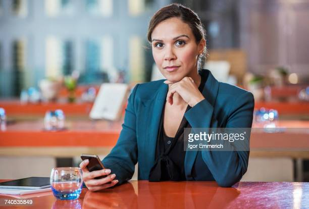 Businesswoman using mobile phone in cafe