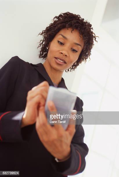 Businesswoman Using Palm Pilot