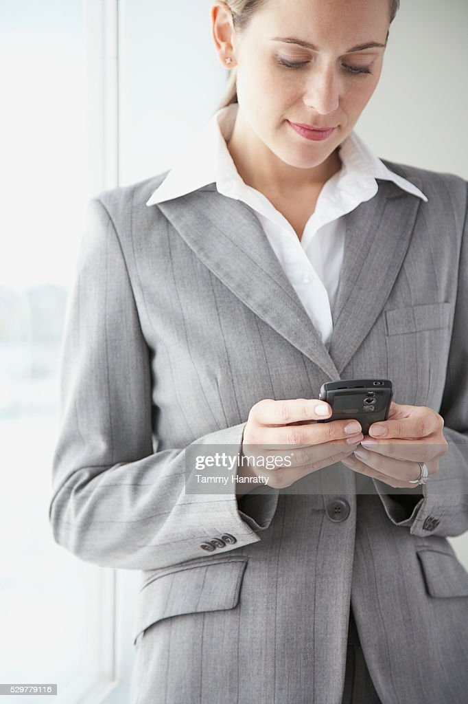 Businesswoman using PDA : ストックフォト