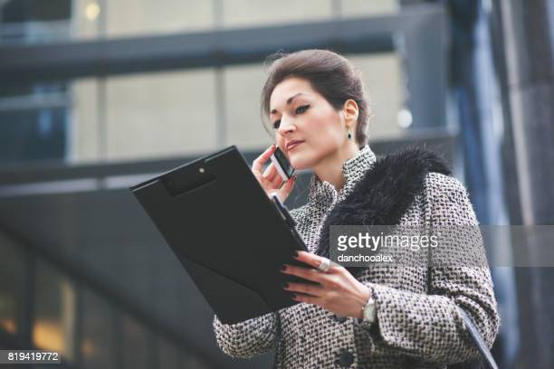 Businesswoman using smart phone outdoors