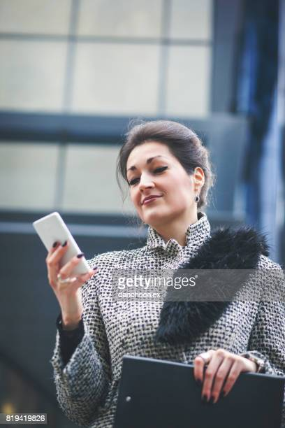 Businesswoman using smart phone