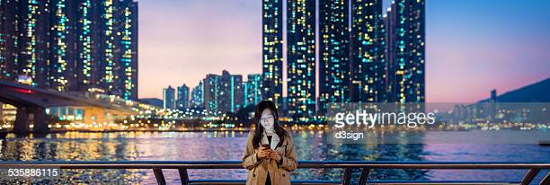 Businesswoman using smartphone in city