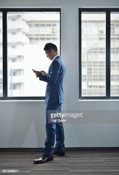 Businesswoman using Smartphone  in empty office