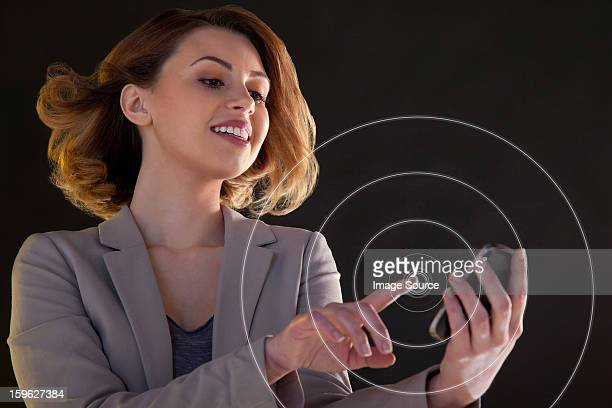 Businesswoman using smartphone touch screen with circles