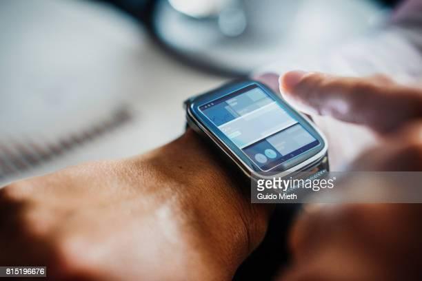 Businesswoman using smartwatch.
