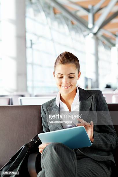 Businesswoman Using Tablet Computer At Departure Lounge