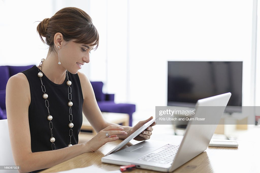 Businesswoman using tablet computer : Stock Photo