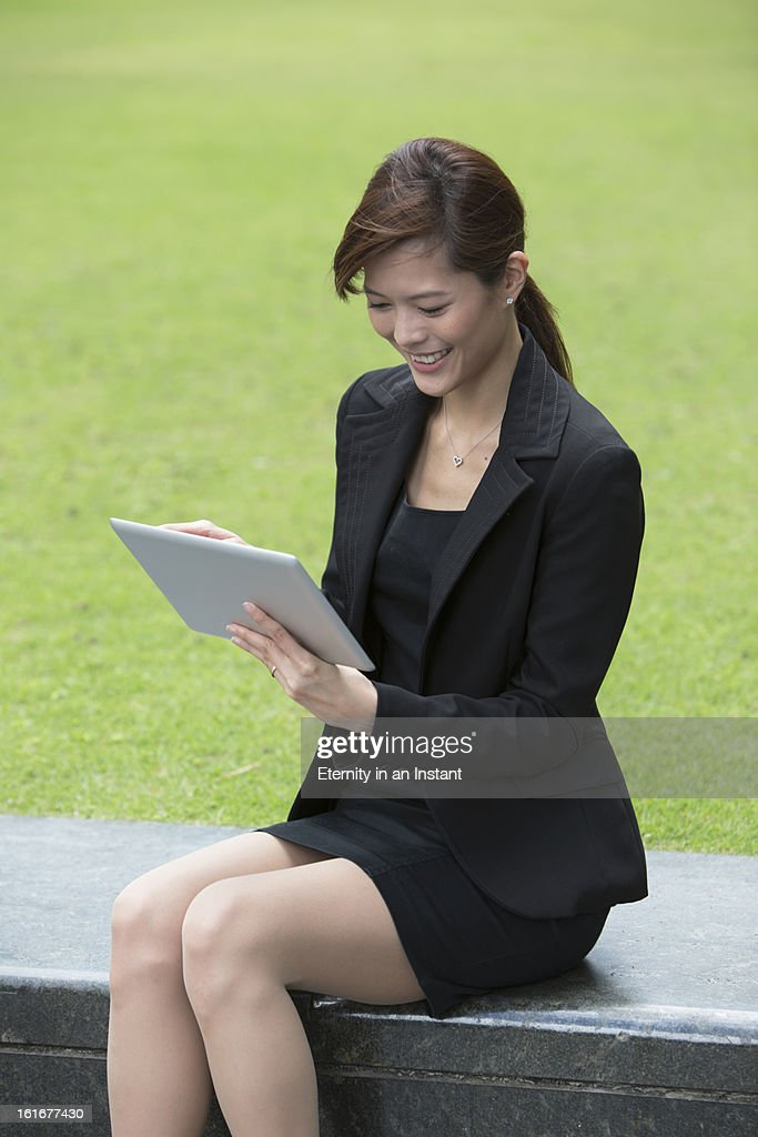 Businesswoman using tablet device : Stock Photo