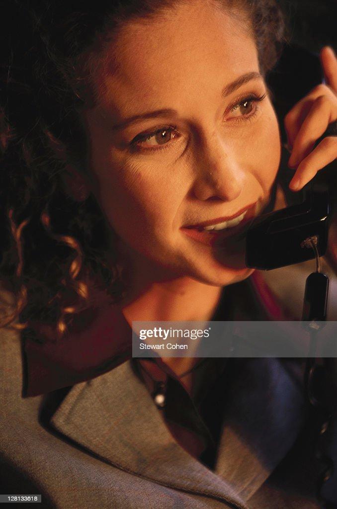 Businesswoman using the telephone : Stock Photo