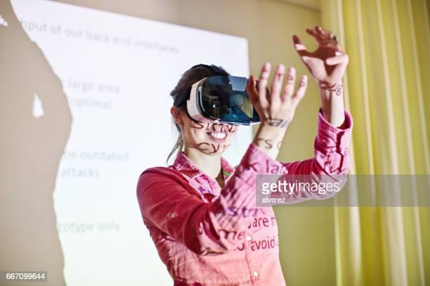 Businesswoman using virtual reality stimulator