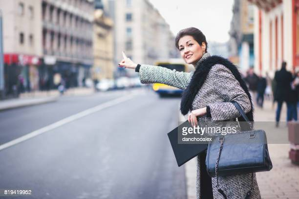 Businesswoman waiting for a cab