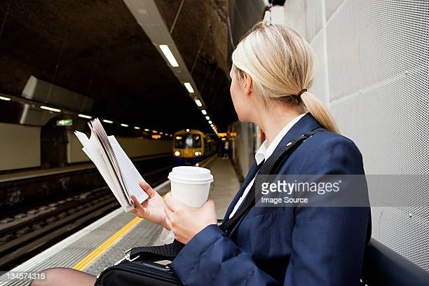 Businesswoman waiting for London Overground train