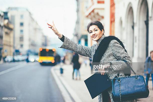 Businesswoman waiting for taxi