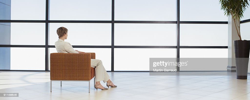 Businesswoman waiting in office waiting area : Stock Photo