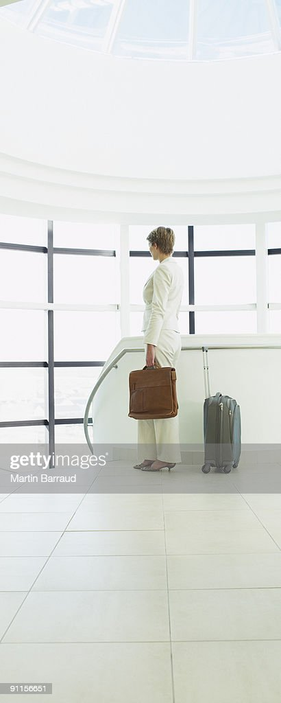 Businesswoman waiting to go on business trip : Stock Photo