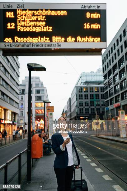 Businesswoman Waiting To Use Public Transport  In The City