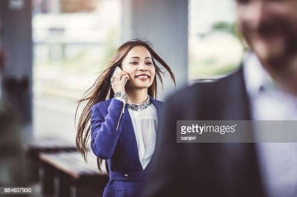 Businesswoman Walking Along Train Station Platform
