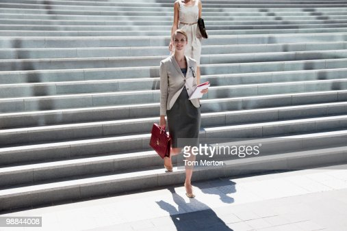 Businesswoman walking down steps outdoors
