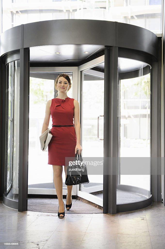 Businesswoman walking in lobby : Stock Photo