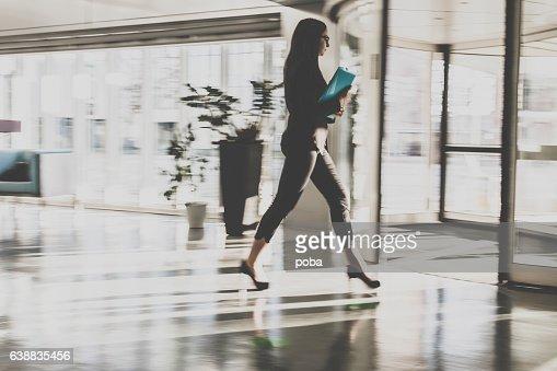Businesswoman walking in lobby