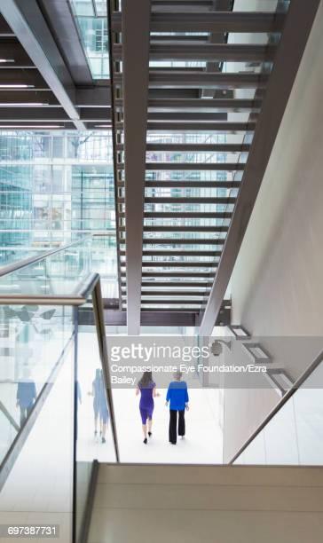 Businesswoman walking in modern office