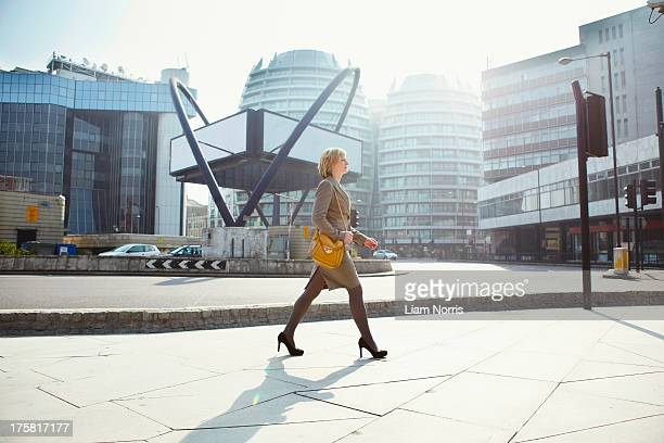 Businesswoman walking in Old Street, London, England, UK