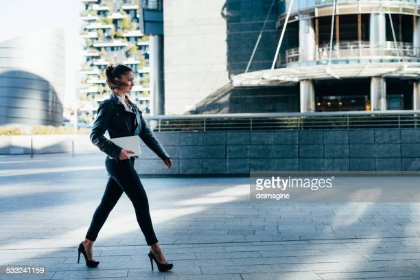 Businesswoman walking in the Financial District