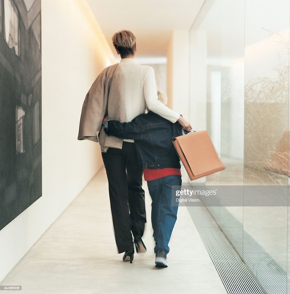 Businesswoman walking with son : Stock Photo
