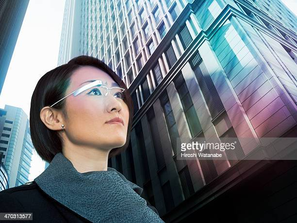 Businesswoman wearing a PC with head-mounted displ
