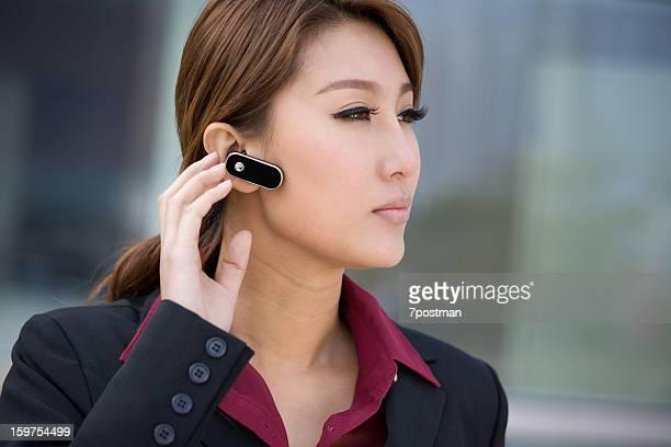 Businesswoman wearing bluetooth