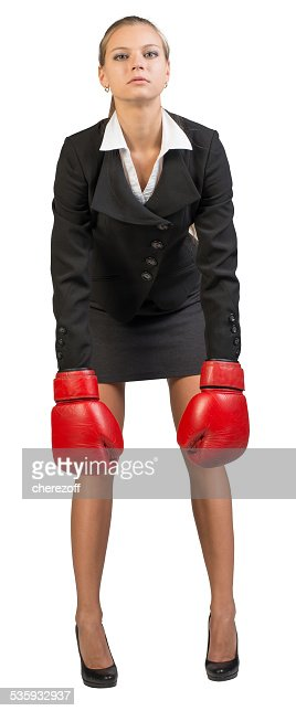 Businesswoman wearing boxing gloves : Stock Photo